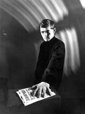 Tom Courtenay in Black Suit With Newspaper