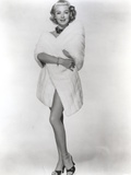 Lana Turner standing in Bathrobe Outfit