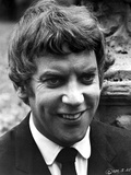 Donald Sutherland smiling in Black Suit