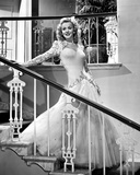 Carole Landis on a Gown smiling and posed