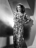 Joan Bennett wearing a Long Floral Gown
