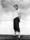 Sandra Dee in White Polo Side View Pose