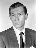 Johnnie Ray Looking Serious in Black Suit
