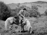 Roy Rogers Riding on a Horse Eating Grass
