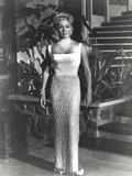 Lana Turner posed in White Long Gown