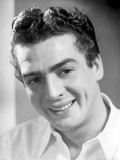 Victor Mature smiling in White Polo