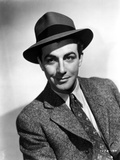 Robert Taylor Posed in Suit and Hat