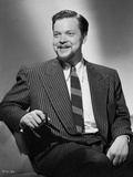 Orson Welles smiling in Coat and Tie