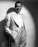 Cab Calloway standing in White Suit