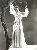 Loretta Young wearing a White Dress