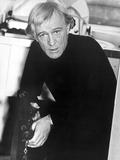 Richard Harris sitting in Black Suit