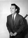 Tennessee Ford standing in Black Suit
