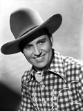 Gene Autry smiling in Western Outfit