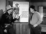 Gene Autry Talking to a Man in Shirt