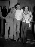 Joan Crawford standing with Friends