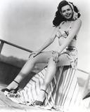 Ann Miller sitting on the Railings