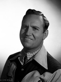 Gene Autry smiling in Western Attire