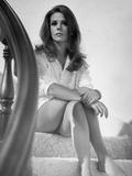 Natalie Wood sitting in White Sleeves