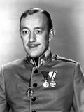 Alec Guinness Posed in Police Uniform