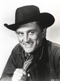 Kirk Douglas smiling in Cowboy Outfit