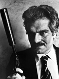 Omar Sharif in Black Suit With Pistol