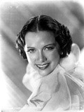 Eleanor Powell smiling in Ruffled Top