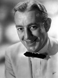 Alec Guinness smiling in White Suit