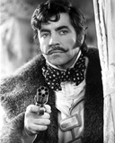 Oliver Reed in Fur Coat With Pistol