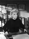 Anne Francis sitting in Black Sweater
