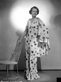Mary Astor on Printed Dress standing