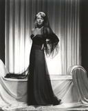 Lana Turner posed in Black Long Gown
