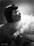 Anna Wong Using a Feather Scarf