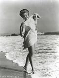 Ann Miller standing at Beach