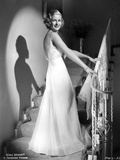 Joan Bennett on a Gown and smiling