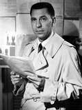 Jack Webb Posed in Coat With Paper