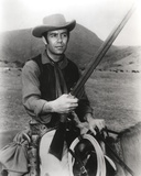 Bonanza Posed on Horse with Rifle