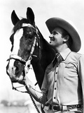 Gene Autry smiling with a Horse