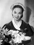 Ann Blyth Carrying a Flowers