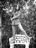 Natalie Wood standing on a Bench