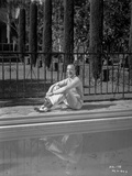 Fred Astaire Seated on Poolside