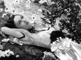 Maureen O'Sullivan on a Gown Lying