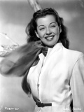 Gail Russell smiling in White