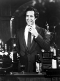 Chevy Chase smiling in Black Suit