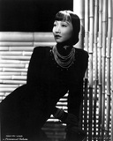 Anna Wong Leaning on a Table