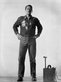 John Wayne next to bomb detonator