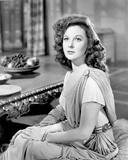 Susan Hayward sitting in a Dress
