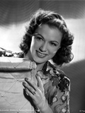 Eleanor Powell sitting and smiling