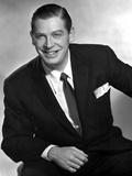 Milton Berle smiling in Black Suit
