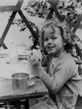 Shirley Temple Eating in Sweater