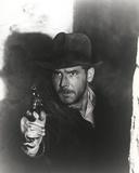 Harrison Ford Pointing a Gun